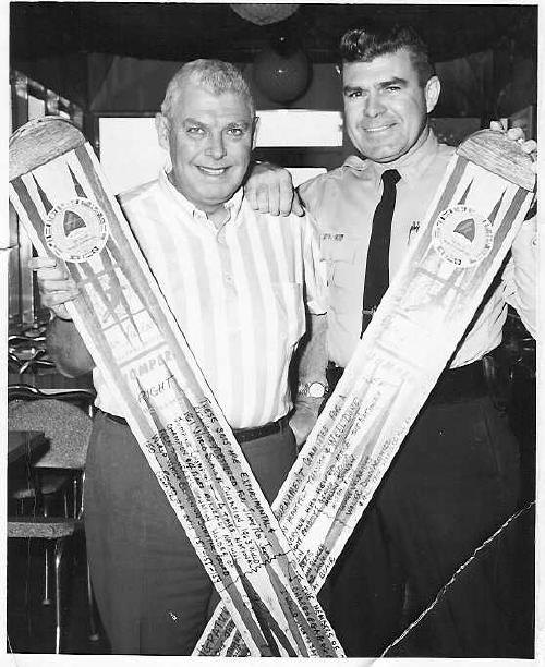 """Pictured are Raymond E. Piehler and Richard Guerinwith the jumping skis used by Jimmy """"the Flea"""" Jackson,winner of Men's Jumping at the 1964 National Ski Tournament held at the lake.The skis were displayed at Snug Harbor until 1968 when the businessclosed due to land taking for Route 52 (now Route 395). Photo from OldeWebster.com"""